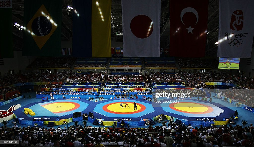 Kenichi Yumoto of Japan competes against Vasyl Fedoryshyn of Ukraine in the men's 60kg freestyle wrestling bronze medal match at the China Agriculture University Gymnasium on Day 11 of the Beijing 2008 Olympic Games on August 19, 2008 in Beijing, China.