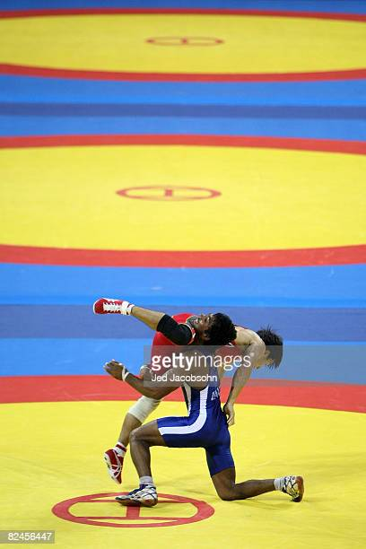 Kenichi Yumoto of Japan competes against Yogeshwar Dutt of India in the 60 kg freestyle wrestling event at the China Agriculture University Gymnasium...