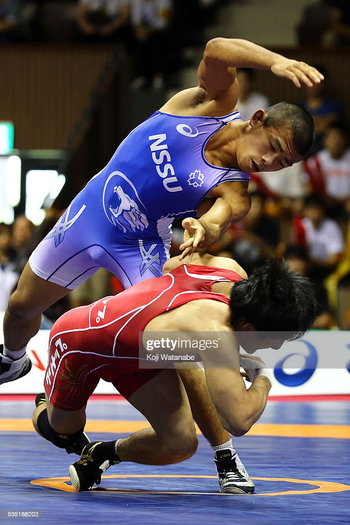 Kenichiro Fumita (blue) competes in the Men's 59kg greco-roman style Fainal match against <a gi-track='captionPersonalityLinkClicked' href=/galleries/search?phrase=Shota+Tanokura&family=editorial&specificpeople=11387677 ng-click='$event.stopPropagation()'>Shota Tanokura</a> (red) during All Japan Wrestling Championships at Yoyogi National Gymnasium on May 29, 2016 in Tokyo, Japan.