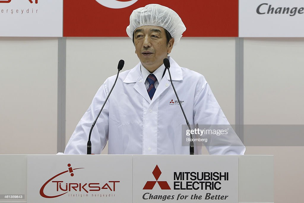 Kenichiro Yamanishi, president and chief executive officer of Mitsubishi Electric Corp., speaks during a ceremony marking the shipment of Turksat AS's Turksat-4A communications satellite, manufactured by Mitsubishi Electric, at the company's satellite production facility at Kamakura Works in Kamakura, Kanagawa Prefecture, Japan, on Wednesday, Jan. 8, 2014. Turksat AS is Turkey's state-owned satellite operator. Photographer: Kiyoshi Ota/Bloomberg via Getty Images