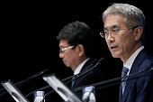 Kenichiro Yoshida chief financial officer of Sony Corp right speaks while Kazuhiko Takeda senior vice president listens during a news conference in...