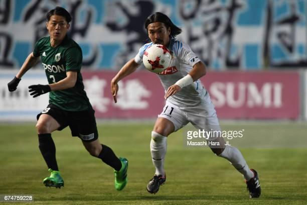 Kenji Baba of Kamatamare Sanuki and Hayuma Tanaka of Matsumoto Yamaga compete for the ball during the JLeague J2 match between Matsumoto Yamaga and...