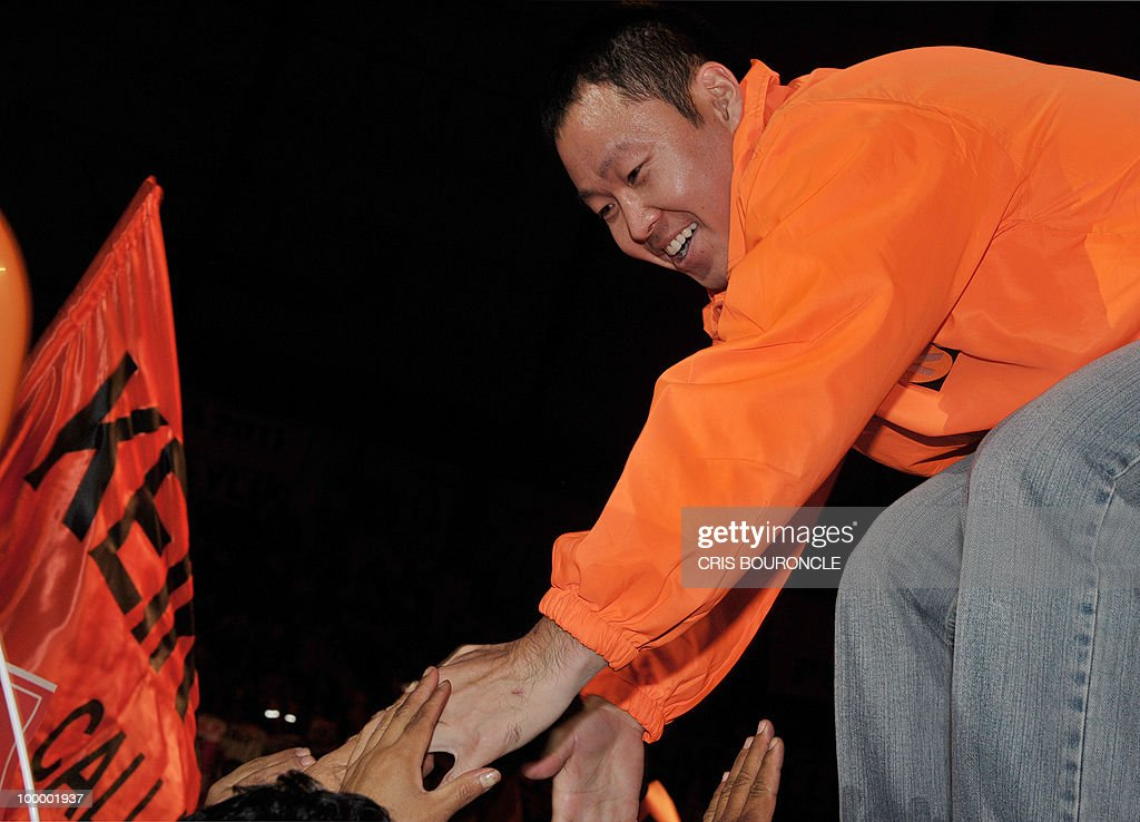 Kenji Fujimori, son of incarcerated former Peruvian president Alberto Fujimori, greets the crowd during his sister�s Keiko presentation of her party �Fuerza 2011� (Strength 2011) to an audience of several thousand followers at a coliseum in Lima on May 19, 2010. Keiko Fujimori, now a Congresswoman who was once Peru�s acting First Lady, hopes her party will succeed in this year�s nationwide mayoral elections and to prevail in next year�s presidential race.