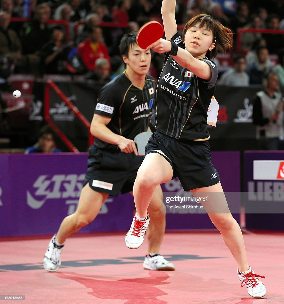 Kenji Matsudaira (L) and Misako Wakamiya of Japan compete against Kim Hyok Bong and Kim Jong of North Korea in the Mixed Doubles 4th round match during day four of the World Table Tennis Championships on May 16, 2013 in Paris, France.