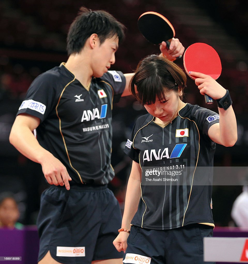 Kenji Matsudaira (L) and Misako Wakamiya of Japan show their dejection as they were beaten by Kim Hyok Bong and Kim JOng of North Korea in the Mixed Doubles 4th round match during day four of the World Table Tennis Championships on May 16, 2013 in Paris, France.