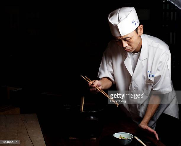 Kenji Nagata a chef at Azabu Yukimura restaurant prepares Takikomi Gohan a rice dish seasoned and cooked with various ingredients at the restaurant...