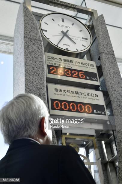 Kenji Shiga director of the Hiroshima Peace Memorial Museum looks at a 'peace clock' monument on Sept 3 at the museum in the city of Hiroshima which...