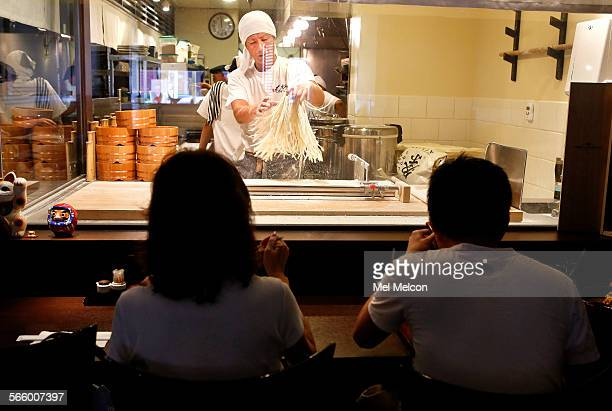 Kenji Tateishi general manager at Monzo restaurant in Little Tokyo shakes udon noodles so they don't stick together while making another fresh batch...