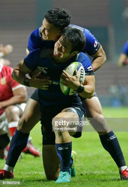 Kenki Fukuoka of Japan celebrates his try with Yu Tamura of Japan during the international match between Japan and Tonga at Stade Ernest Wallon on...