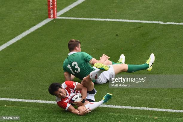 Kenki Fukuoka of Japan competes for the ball against Garry Ringrose of Ireland during the international rugby friendly match between Japan and...