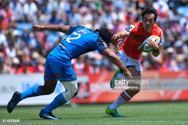 Kenki Fukuoka of Sunwolves hands off against Tinoai Faiane of Blues during the Super Rugby match between the Sunwolves and the Blues at Prince...