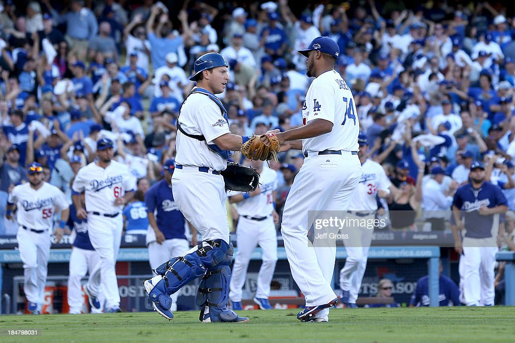 <a gi-track='captionPersonalityLinkClicked' href=/galleries/search?phrase=Kenley+Jansen&family=editorial&specificpeople=5751411 ng-click='$event.stopPropagation()'>Kenley Jansen</a> #74 and A.J. Ellis #17 of the Los Angeles Dodgers celebrate after the Dodgers defeat the St. Louis Cardinals 6-4 in Game Five of the National League Championship Series at Dodger Stadium on October 16, 2013 in Los Angeles, California.