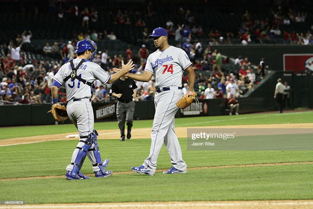 <a gi-track='captionPersonalityLinkClicked' href=/galleries/search?phrase=Kenley+Jansen&family=editorial&specificpeople=5751411 ng-click='$event.stopPropagation()'>Kenley Jansen</a> #74 and <a gi-track='captionPersonalityLinkClicked' href=/galleries/search?phrase=Drew+Butera&family=editorial&specificpeople=4175498 ng-click='$event.stopPropagation()'>Drew Butera</a> #31 of the Los Angeles Dodgers celebrate their 8-5 victory over the Arizona Diamondbacks at Chase Field on April 12, 2014 in Phoenix, Arizona.