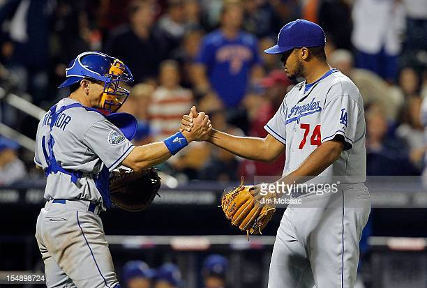 Kenley Jansen and Matt Treanor of the Los Angeles Dodgers in action against the New York Mets at Citi Field on July 20 2012 in the Flushing...