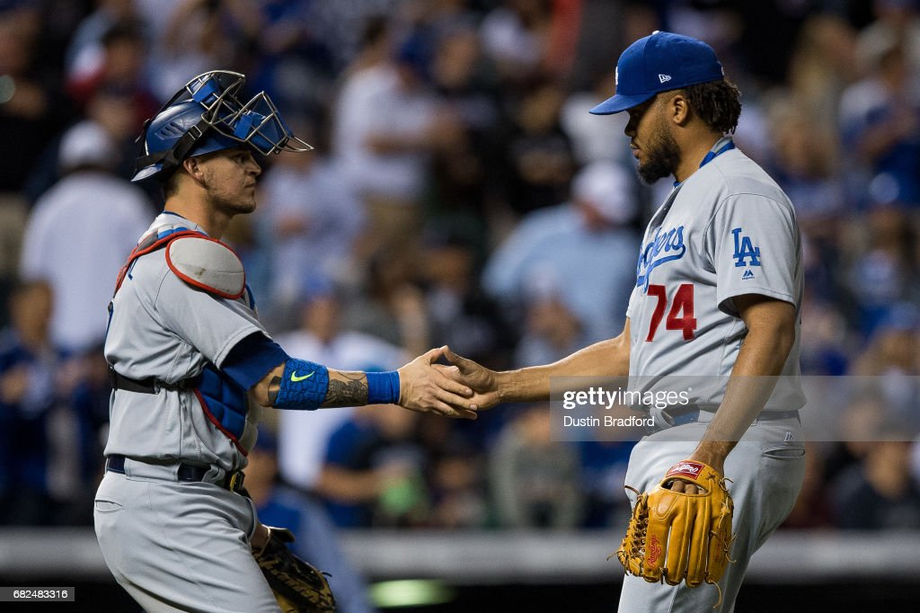 Kenley Jansen #74 and Yasmani Grandal #9 of the Los Angeles Dodgers celebrate after a 6-2 win over the Colorado Rockies at Coors Field on May 12, 2017 in Denver, Colorado.