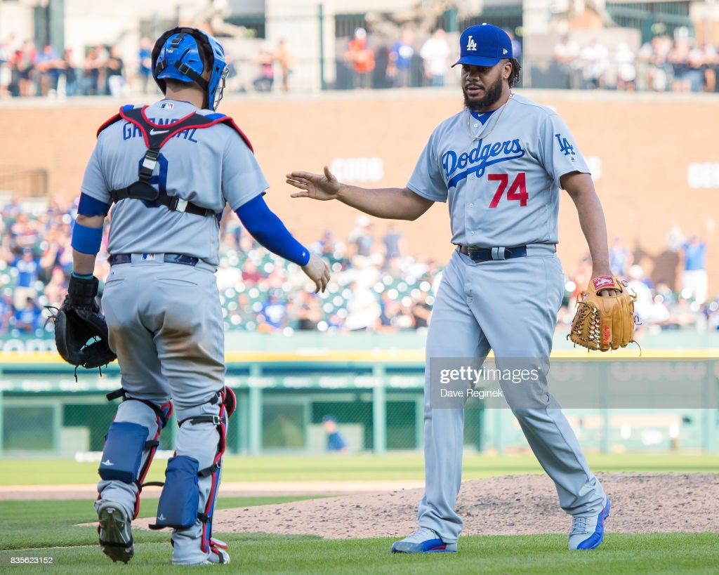 Kenley Jansen #74 of the Los Angeles Dodgers celebrates a 3-0 win over the Detroit Tigers with teammate Yasmani Grandal #9 after a MLB game at Comerica Park on August 19, 2017 in Detroit, Michigan.