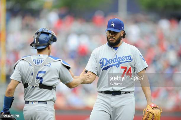 Kenley Jansen of the Los Angeles Dodgers celebrates with Austin Barnes after a 32 victory against the Washington Nationals at Nationals Park on...