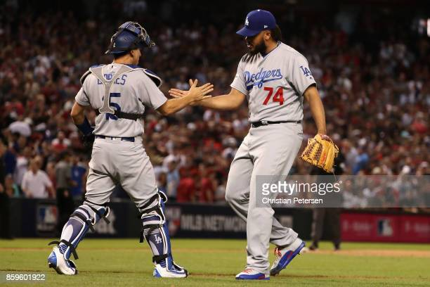 Kenley Jansen of the Los Angeles Dodgers celebrates with Austin Barnes after defeating the Arizona Diamondbacks 31 to win the National League...