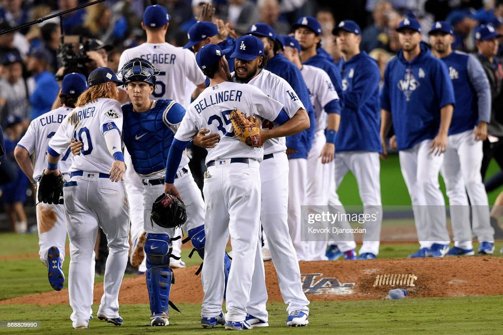 Kenley Jansen #74 of the Los Angeles Dodgers celebrates with Cody Bellinger #35 after defeating the Houston Astros 3-1 in game six of the 2017 World Series at Dodger Stadium on October 31, 2017 in Los Angeles, California.