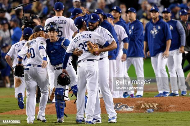 Kenley Jansen of the Los Angeles Dodgers celebrates with Cody Bellinger after defeating the Houston Astros 31 in game six of the 2017 World Series at...