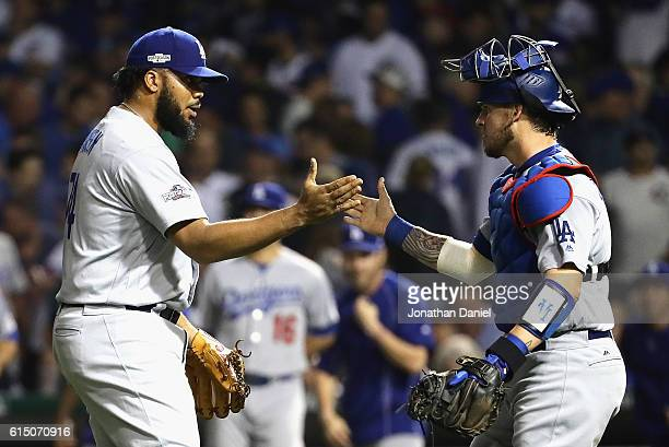 Kenley Jansen of the Los Angeles Dodgers celebrates with Yasmani Grandal after defeating the Chicago Cubs 10 in game two of the National League...