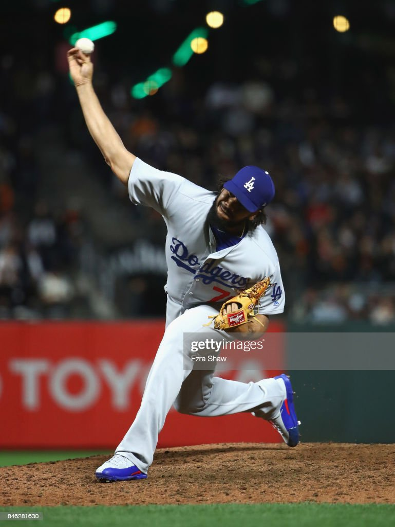 Kenley Jansen #74 of the Los Angeles Dodgers pitches against the San Francisco Giants in the eighth inning at AT&T Park on September 12, 2017 in San Francisco, California.