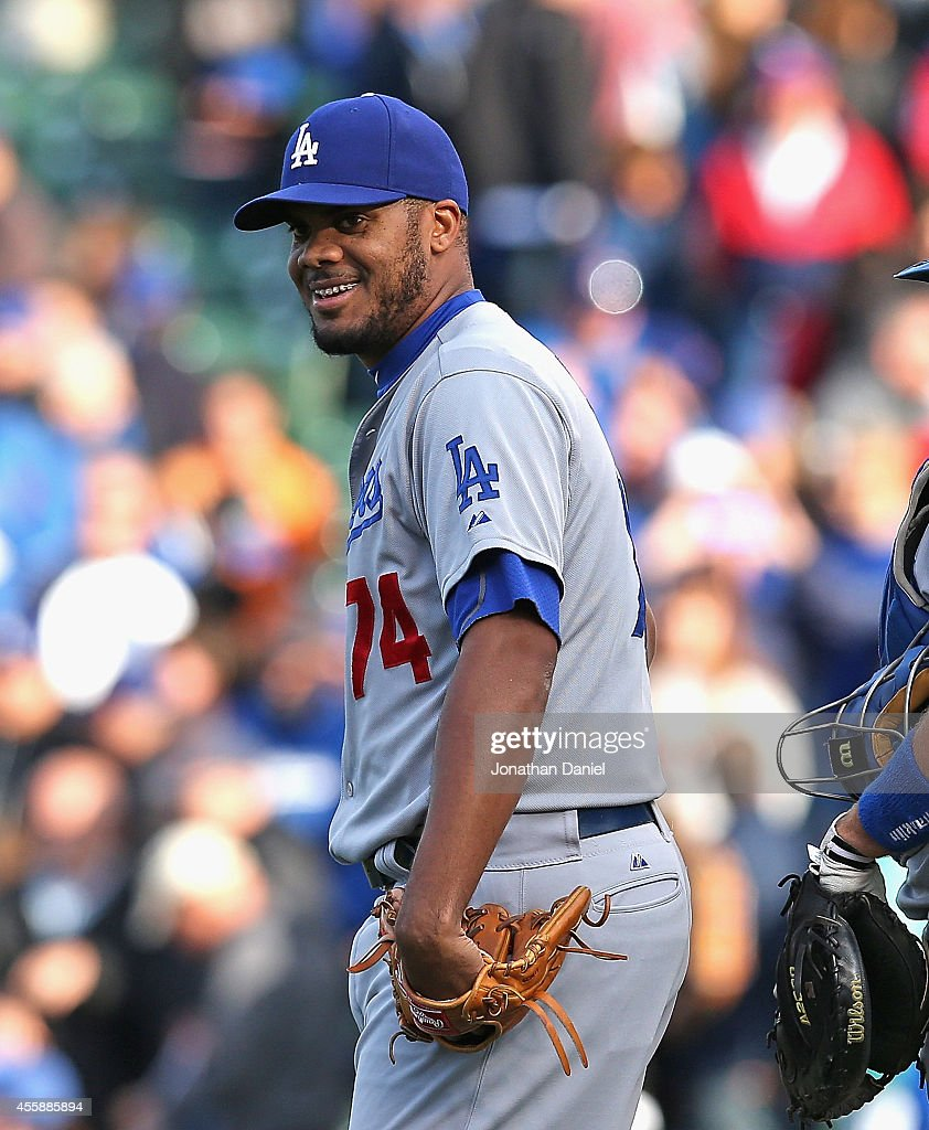 Kenley Jansen #74 of the Los Angeles Dodgers smiles after earning his 43rd save of the season against the Chicago Cubs at Wrigley Field on September 21, 2014 in Chicago, Illinois. The Dodgers defeated the Cubs 8-5.