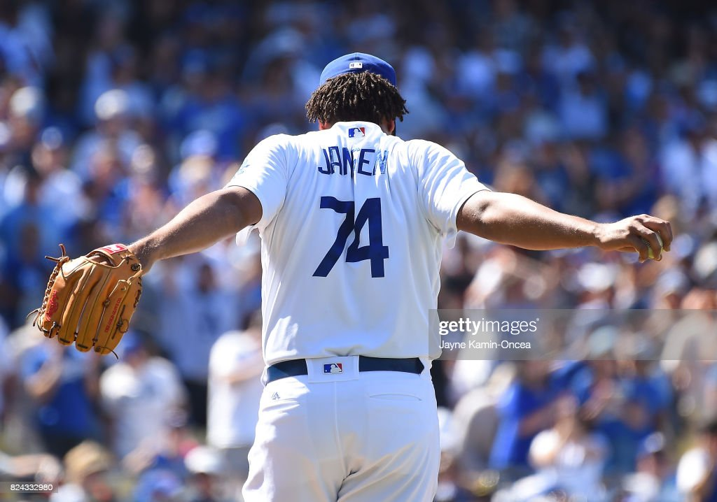 Kenley Jansen #74 of the Los Angeles Dodgers stretches before throwing the final pitch of the game to strike out Jae-Gyun Hwang #1 of the San Francisco Giants in the ninth inning of the game at Dodger Stadium on July 29, 2017 in Los Angeles, California.