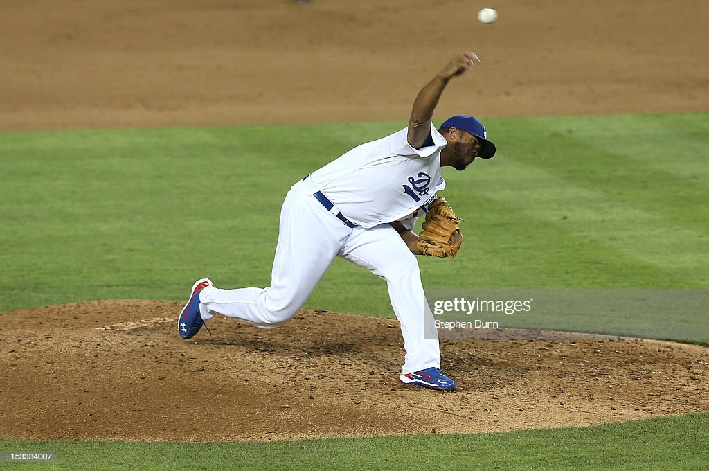 <a gi-track='captionPersonalityLinkClicked' href=/galleries/search?phrase=Kenley+Jansen&family=editorial&specificpeople=5751411 ng-click='$event.stopPropagation()'>Kenley Jansen</a> #74 of the Los Angeles Dodgers throws a pitch in the ninth inning against the San Francisco Giants on October 3, 2012 at Dodger Stadium in Los Angeles, California. The Dodgers won 5-1.