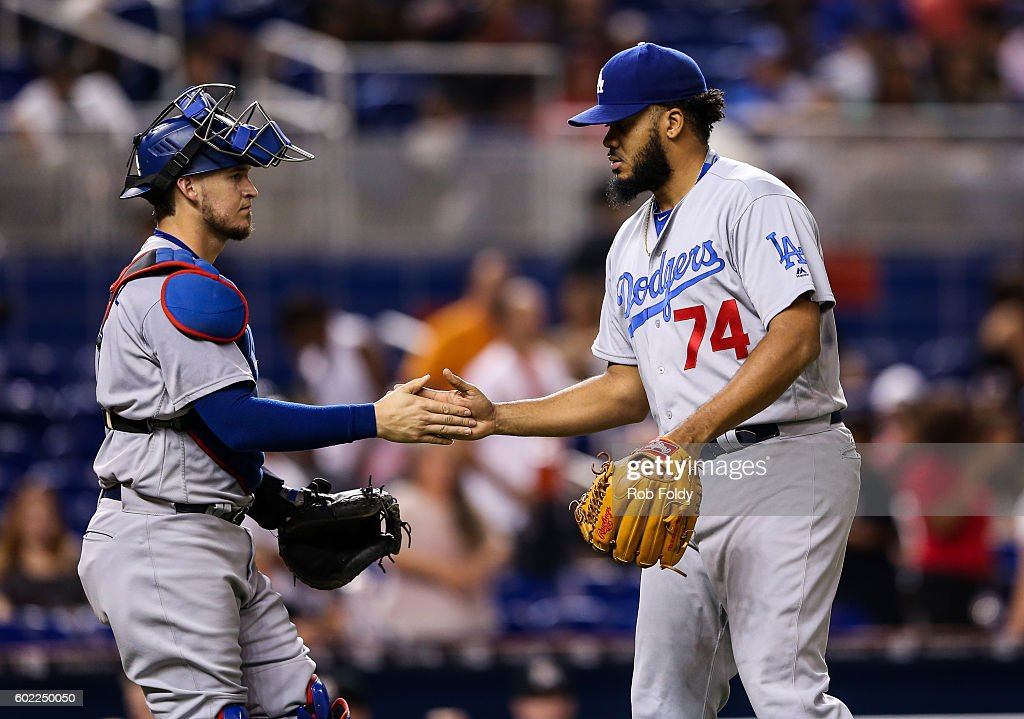 Kenley Jansen #74 shakes hands with Yasmani Grandal #9 of the Los Angeles Dodgers after the game against the Miami Marlins at Marlins Park on September 10, 2016 in Miami, Florida.