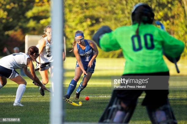 Kennebunk forward Christine Jarowicz approaches Westbrook goalie Kimberly Goddard while maneuvering around Ariana St Clair far left and Abigail...