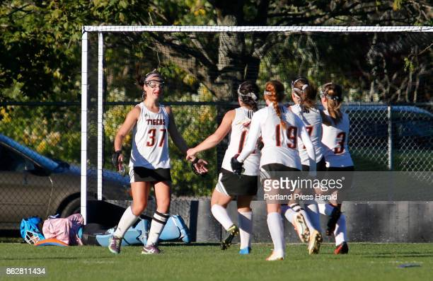 Kennebunk vs Biddeford Class A South quarterfinal Hailey Allen of Biddeford is met by teammates after scoring the tie goal on a penalty shot in the...
