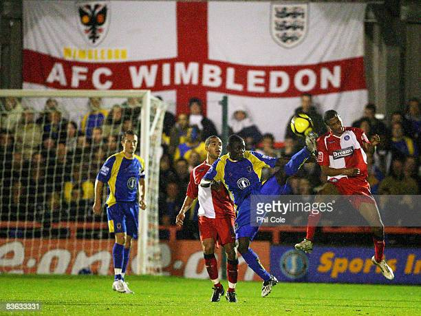 Kennedy Adjei of AFC Wimbledon tackles Chris Zebroski of Wycombe Wanders during the FA Cup 1st Round match between AFC Wimbledon and Wycombe...
