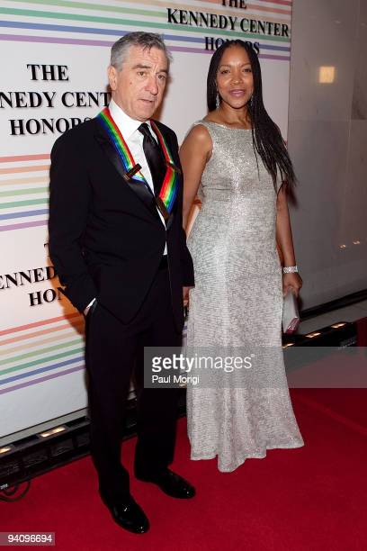 Kennedy Center honoree actor Robert De Niro arrives with Grace Hightower at the 32nd Kennedy Center Honors at Kennedy Center Hall of States on...