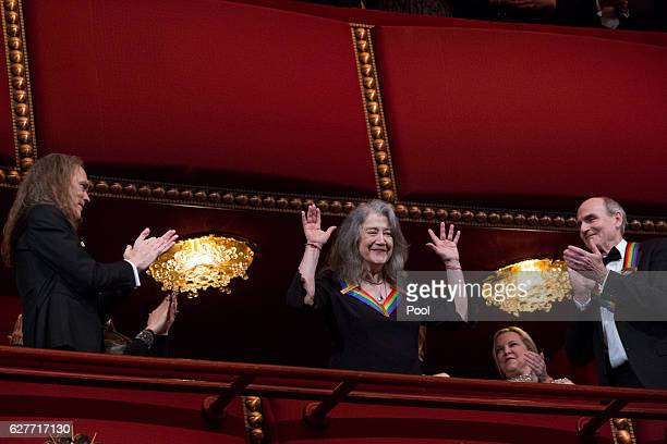 Kennedy Center Honoree pianist Martha Argerich waves at the beginning of the show during the Kennedy Center Honors December 4 2016 at the Kennedy...