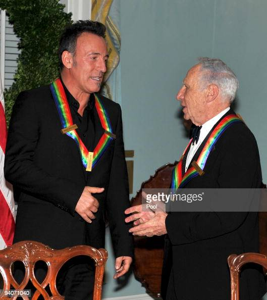 Kennedy Center honorees Bruce Springsteen left and Mel Brooks right engage in conversation as they prepare to pose with the other honorees for the...