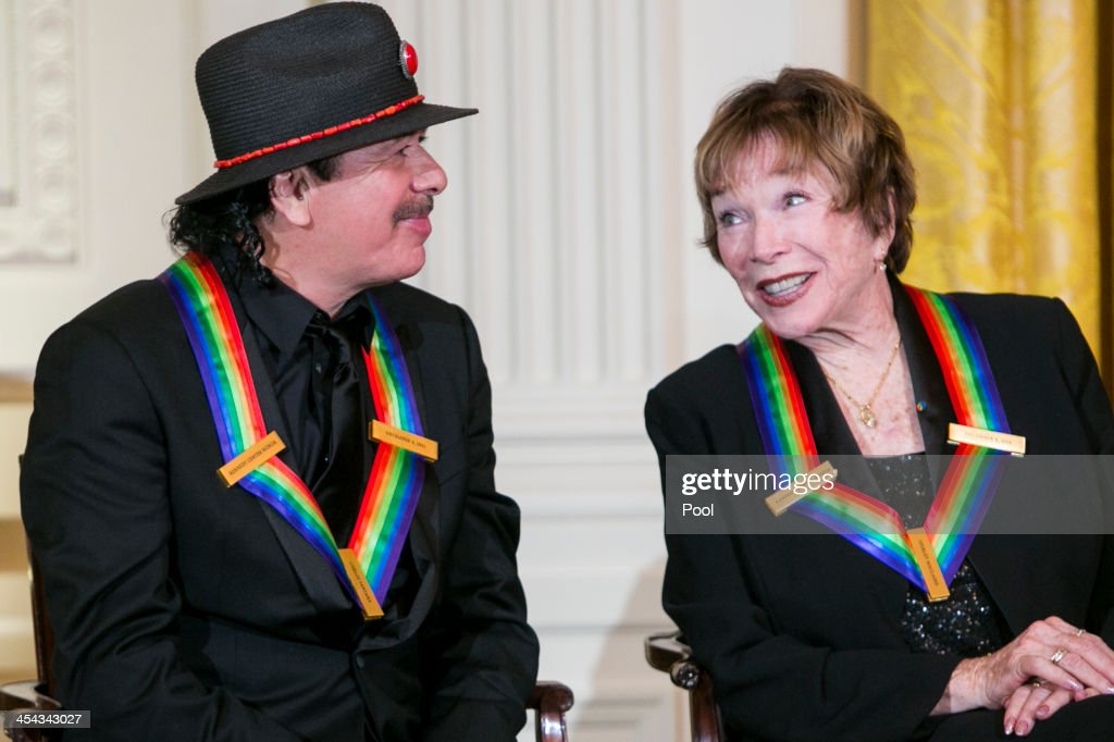 Kennedy Center Honorees <a gi-track='captionPersonalityLinkClicked' href=/galleries/search?phrase=Carlos+Santana+-+Musician&family=editorial&specificpeople=11497837 ng-click='$event.stopPropagation()'>Carlos Santana</a> and <a gi-track='captionPersonalityLinkClicked' href=/galleries/search?phrase=Shirley+MacLaine&family=editorial&specificpeople=204788 ng-click='$event.stopPropagation()'>Shirley MacLaine</a> attend a reception at the White House for the 2013 Kennedy Center Honorees on December 8, 2013 in Washington, DC. The honorees this year include: opera singer Martina Arroyo, jazz musician Herbie Hancock, musician Billy Joel, actress <a gi-track='captionPersonalityLinkClicked' href=/galleries/search?phrase=Shirley+MacLaine&family=editorial&specificpeople=204788 ng-click='$event.stopPropagation()'>Shirley MacLaine</a> and musician <a gi-track='captionPersonalityLinkClicked' href=/galleries/search?phrase=Carlos+Santana+-+Musician&family=editorial&specificpeople=11497837 ng-click='$event.stopPropagation()'>Carlos Santana</a>.