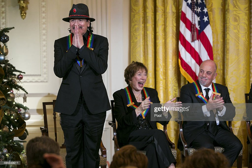 Kennedy Center Honorees <a gi-track='captionPersonalityLinkClicked' href=/galleries/search?phrase=Carlos+Santana+-+Musician&family=editorial&specificpeople=11497837 ng-click='$event.stopPropagation()'>Carlos Santana</a>, <a gi-track='captionPersonalityLinkClicked' href=/galleries/search?phrase=Shirley+MacLaine&family=editorial&specificpeople=204788 ng-click='$event.stopPropagation()'>Shirley MacLaine</a> and <a gi-track='captionPersonalityLinkClicked' href=/galleries/search?phrase=Billy+Joel&family=editorial&specificpeople=203097 ng-click='$event.stopPropagation()'>Billy Joel</a> attend a reception at the White House for the 2013 Kennedy Center Honorees on December 8, 2013 in Washington, DC. The honorees this year include: opera singer Martina Arroyo, jazz musician Herbie Hancock, musician <a gi-track='captionPersonalityLinkClicked' href=/galleries/search?phrase=Billy+Joel&family=editorial&specificpeople=203097 ng-click='$event.stopPropagation()'>Billy Joel</a>, actress <a gi-track='captionPersonalityLinkClicked' href=/galleries/search?phrase=Shirley+MacLaine&family=editorial&specificpeople=204788 ng-click='$event.stopPropagation()'>Shirley MacLaine</a> and musician <a gi-track='captionPersonalityLinkClicked' href=/galleries/search?phrase=Carlos+Santana+-+Musician&family=editorial&specificpeople=11497837 ng-click='$event.stopPropagation()'>Carlos Santana</a>.