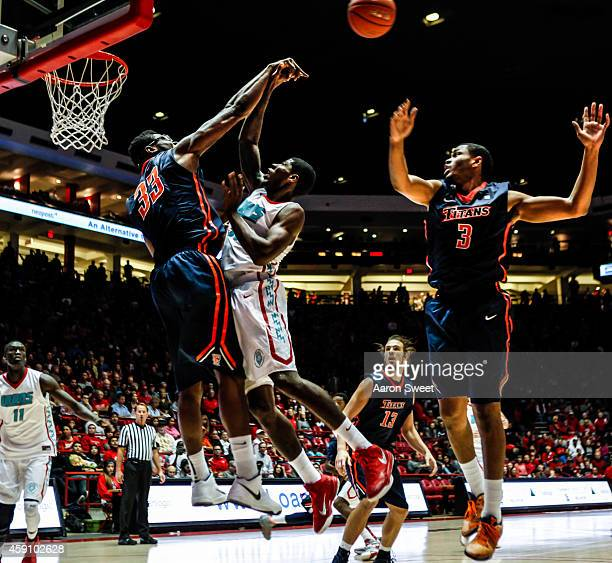 kennedy esume of the cal state fullerton titans swats a shot attempt by deshawn delaney of