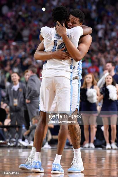 Kennedy Meeks and Brandon Robinson of the North Carolina Tar Heels embrace each other following the 2017 NCAA Men's Final Four National Championship...
