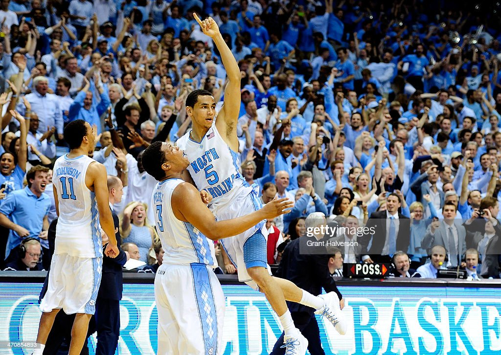 Kennedy Meeks and Marcus Paige of the North Carolina Tar Heels celebrate after a win over the Duke Blue Devils at the Dean Smith Center on February...