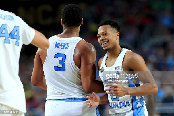 Kennedy Meeks and Nate Britt of the North Carolina Tar Heels react in the first half against the Oregon Ducks during the 2017 NCAA Men's Final Four...