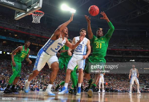 Kennedy Meeks of the North Carolina Tar Heels and Dylan Ennis of the Oregon Ducks go for a loose ball in the first half during the 2017 NCAA Men's...