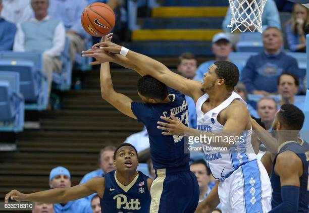 Kennedy Meeks of the North Carolina Tar Heels battles Cameron Johnson of the Pittsburgh Panthers for a rebound during the game at the Dean Smith...