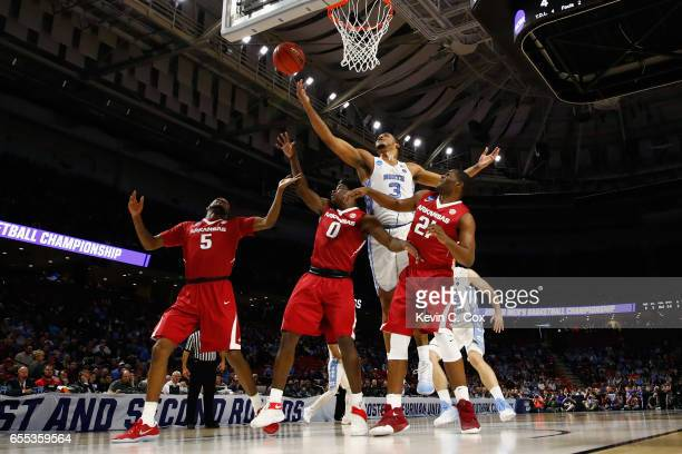 Kennedy Meeks of the North Carolina Tar Heels battles for a rebound in the first half against the Arkansas Razorbacks during the second round of the...