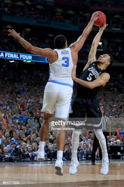 Kennedy Meeks of the North Carolina Tar Heels blocks Nigel WilliamsGoss of the Gonzaga Bulldogs late in the second half during the 2017 NCAA Men's...