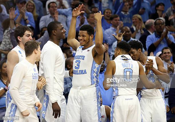 Kennedy Meeks of the North Carolina Tar Heels celebrates with his teammates on the bench late in the second half against the Notre Dame Fighting...