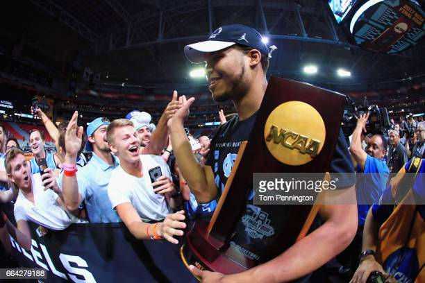 Kennedy Meeks of the North Carolina Tar Heels celebrates with the championship trophy after defeating the Gonzaga Bulldogs during the 2017 NCAA Men's...