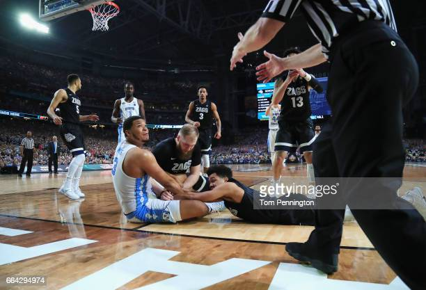 Kennedy Meeks of the North Carolina Tar Heels competes for the ball with Silas Melson and Przemek Karnowski of the Gonzaga Bulldogs in the second...