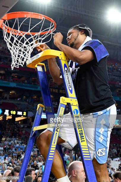 Kennedy Meeks of the North Carolina Tar Heels cuts a piece of the net during the 2017 NCAA Men's Final Four National Championship game against the...